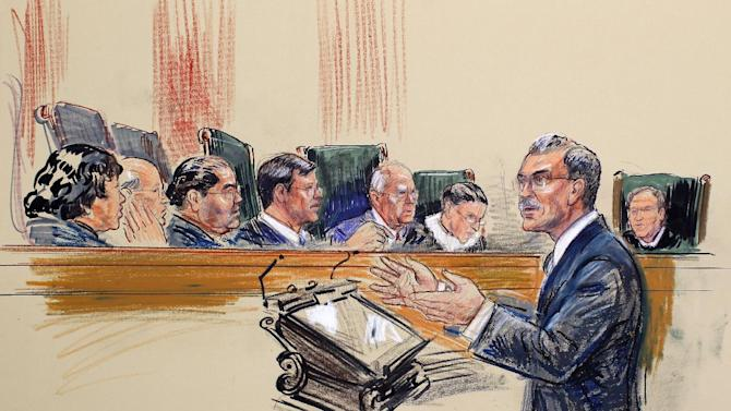 "This artist rendering shows Solicitor General Donald Verrilli Jr. speaks before the Supreme Court in Washington, Wednesday, April 25, 2012, during the court's hearing on Arizona's ""show me your papers"" immigration law. Justice, seated, from left are, Sonia Sotomayor, Stephen Breyer, Antonin Scalia, Chief Justice John Roberts, Anthony Kennedy, Ruth Bader Ginsburg and Samuel Alito.  (AP Photo/Dana Verkouteren)"