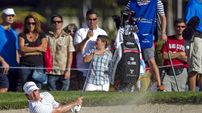 Tim Clark, of South Africa, follows his shot out of a greenside bunker on the 13th hole during the final round of the Sony Open golf tournament, Sunday, Jan. 13, 2013, in Honolulu. (AP Photo/Marco Garcia)