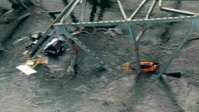 Truck strike may have caused Washington state bridge collapse, officials says