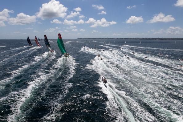 Groupama Sailing Team, skippered by Franck Cammas from France, chase the fleet, at the start of leg 9 of the Volvo Ocean Race from Lorient, France to Galway, Ireland on July 1, 2012 at Sea. (Photo by