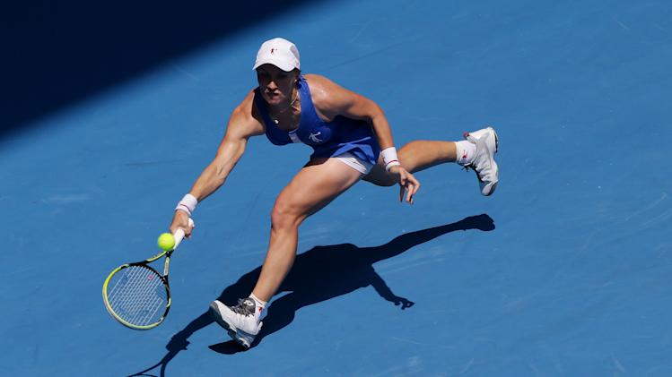 Russia's Svetlana Kuznetsova hits a forehand return to Denmark's Caroline Wozniacki during their fourth round match at the Australian Open tennis championship in Melbourne, Australia, Monday, Jan. 21, 2013. (AP Photo/Dita Alangkara)