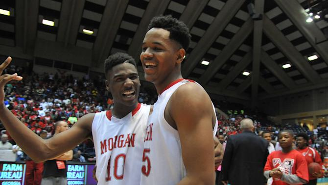 Morgan County's Devorious Brown (10) and Jailyn Ingram (15) celebrate after a GHSA Class AAA boys state basketball championship game, Saturday, March 8, 2014 in Macon, Ga. (AP Photo/Atlanta Journal-Constitution, Kent D. Johnson) MARIETTA DAILY OUT; GWINNETT DAILY POST OUT; LOCAL TV OUT; WXIA-TV OUT; WGCL-TV OUT