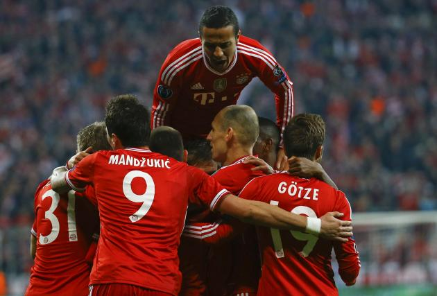 Bayern Munich's Schweinsteiger celebrates with team mates after scoring a goal against Arsenal during their Champions League round of 16 second leg soccer match in Munich