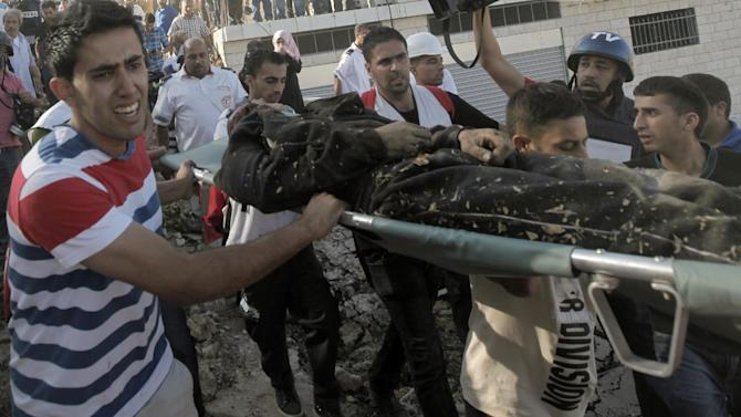 Palestinians evacuate the body of Fatah militant Zacharia Akra, who was killed by Israeli soldiers in a shootout in the West Bank village of Qabalan, on August 11, 2014