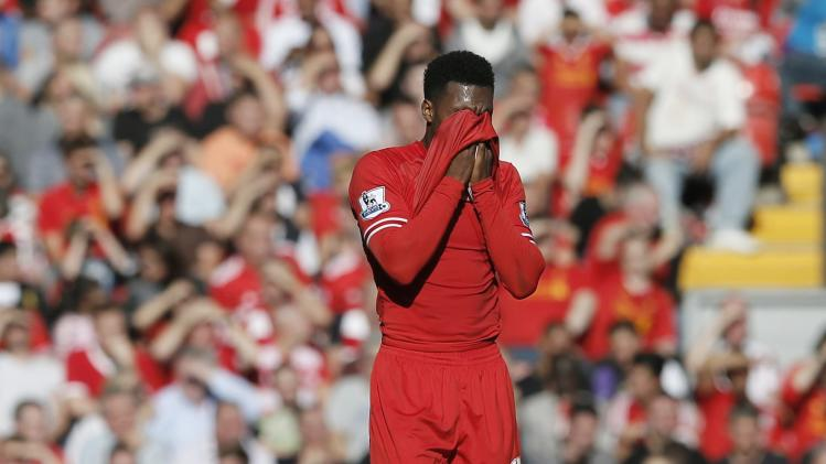 Liverpool's Sturridge wipes his fsce with his shirt during their English Premier League soccer match against Southampton at Anfield in Liverpool