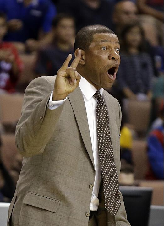 The Los Angeles Clippers head coach Doc Rivers instructs his team during the second half of a preseason NBA basketball game against the Denver Nuggets on Saturday, Oct. 19, 2013, in Las Vegas. The Cli