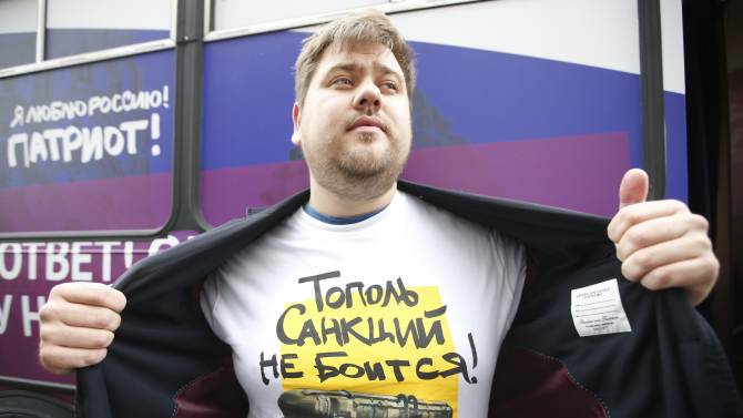 A man demonstrates a T-shirt as he takes part in a campaign organized by activists of pro-Kremlin patriotic movements in central Moscow