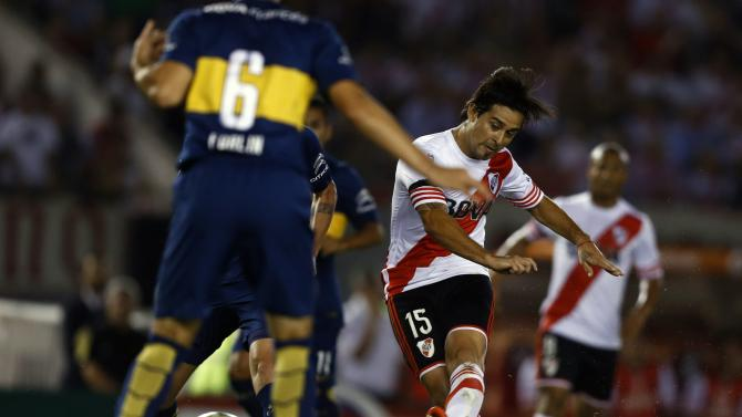 River Plate's Leonardo Pisculichi takes a shot to score against Boca Juniors in the Copa Sudamericana second leg semi-final soccer match in Buenos Aires