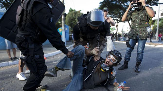 Brazil protesters, police clash near match