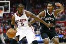 Atlanta Hawks forward DeMarre Carroll (5) drives against Brooklyn Nets forward Joe Johnson (7) in the first half of an NBA playoff basketball game Sunday, April 19, 2015, in Atlanta. (AP Photo/John Bazemore)