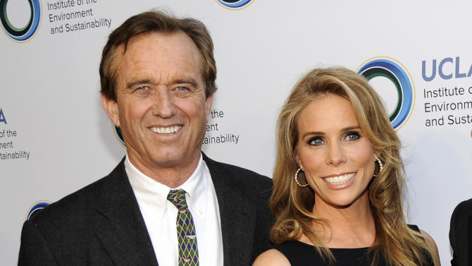 FILE - This March 21, 2014 file photo shows actress Cheryl Hines, right, posing with her fiance Robert F. Kennedy Jr., at the UCLA Institute of the Environment and Sustainability's An Evening of Environmental Excellence in Beverly Hills, Calif. Kennedy Jr. and Hines are planning to wed at the Kennedy compound on Cape Cod. Kennedy's cousin, former Rep. Patrick Kennedy, says the wedding is planned for Saturday afternoon, Aug. 2, at Ethel Kennedy's home in Hyannis Port, Mass. (Photo by Chris Pizzello/Invision/AP, File)