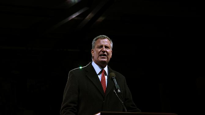 Mayor of New York City Bill de Blasio speaks at a protest against U.S. President-elect Donald Trump outside the Trump International Hotel in New York City