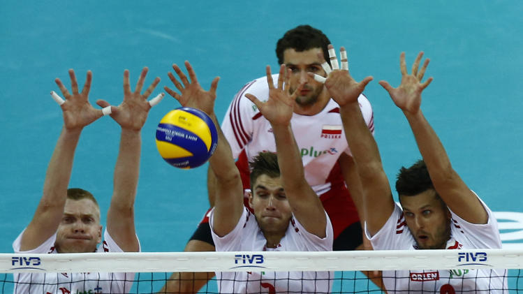 Poland's Zagumny, Klos, Winiarski jump to block the ball as they play against Serbia during FIVB Volleyball Men's World Championship in Warsaw