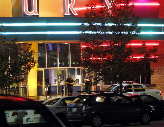 Police are pictured outside of a  Century 16 movie theatre where as many as 14 people were killed and many injured at a shooting during the showing of a movie at the in Aurora, Colo., Friday, July 20,
