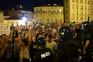 <p>Riot police oficers hold back protesters duing a demonstration in front of parliament in Lisbon. Mass protests in Spain and Portugal, against ever tougher austerity measures, have ramped up the pressure on Iberian governments struggling to avoid international bailouts.</p>
