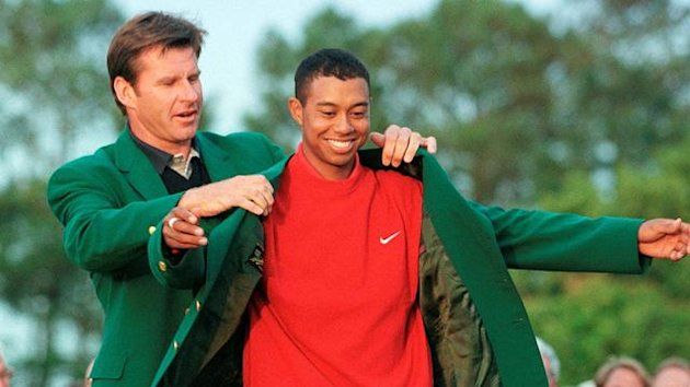 Tiger Woods of the U.S. is given the victor's green jacket after winning the Masters golf tournament in Augusta