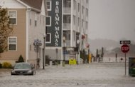 <p>A car sits in a flooded street of Ocean City, Maryland, as Hurricane Sandy nears landfall in the area. The massive storm bashing the US East Coast froze commerce, shut down stock exchanges for the first time since the 9/11 attacks and idled millions of workers Monday, laying siege to an economy still trying to get out of first gear.</p>