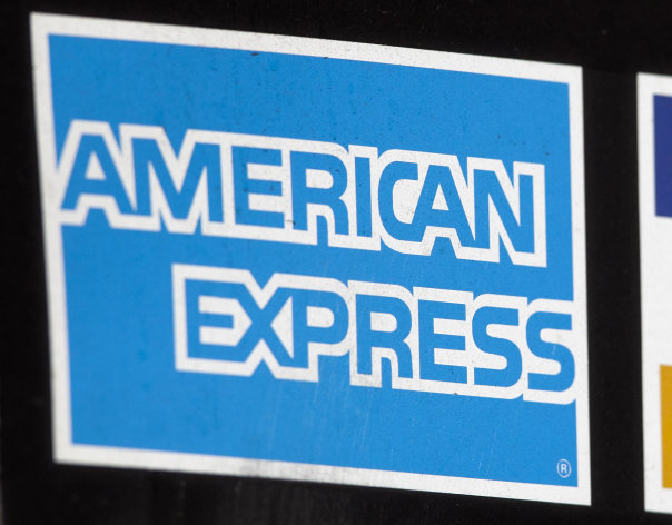 FILE - This March 19, 2012 file photo shows a sign for American Express in New York. American Express says its net income rose 1 percent in the third quarter as its customers spent more money, boosting revenue for the credit card issuer. But the rate of growth in customer spending was slower than earlier this year, echoing a trend among major card issuers. The New York-based company said Wednesday, Oct. 17, 2012 that it posted net income of $1.25 billion, or $1.09 per share, for the three months ended Sept. 30. (AP Photo/Mark Lennihan, File)