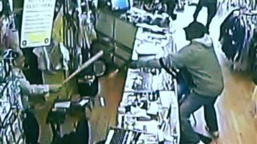 Store Owner Takes On Robbers With Baseball Bat