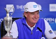 Ernie Els of South Africa smiles next to the Claret Jug during a press conference after winning the 2012 British Open Golf Championship at Royal Lytham and St Annes