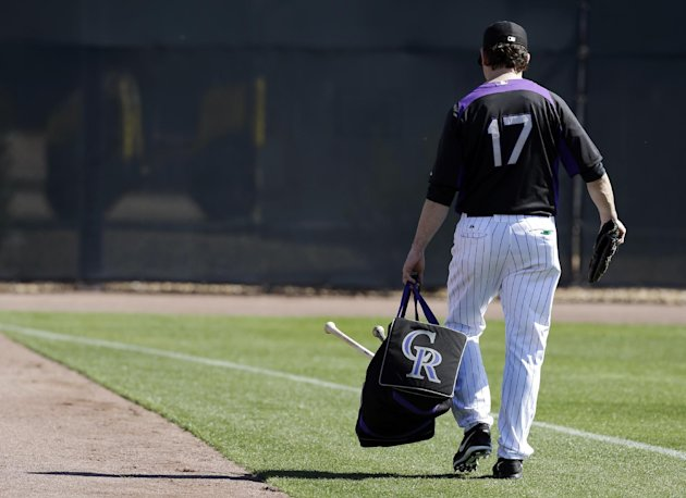 Colorado Rockies' Todd Helton walks to the outfield after batting practice during a spring training baseball workout, Sunday, Feb. 17, 2013, in Scottsdale, Ariz. (AP Photo/Darron Cummings)