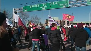 Idle No More protesters gather near the Ambassador Bridge in Windsor, Ont. on Wednesday as part of the grassroots movement's national day of action. 