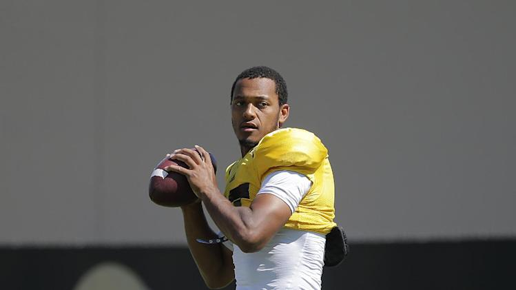 UCLA quarterback Brett Hundley looks to throw a pass during NCAA college football practice Wednesday, Aug. 20, 2014, in Los Angeles