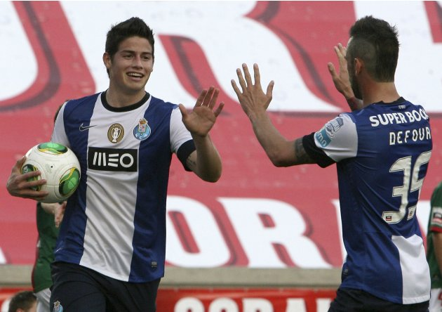 Porto's James Rodriguez celebrates his goal against Maritimo with teammate Steven Defour during their Portuguese Premier League soccer match at Barreiros stadium in Funchal