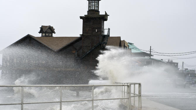 High winds, high tide strike at the main street of Cedar Key, Fla., as Tropical Storm Debby makes it's way across the Gulf of Mexico early Sunday, June 24, 2012. Parts of Florida, including the Panhandle, remain under a tropical storm warning as Debby churns off the Gulf Coast. (AP Photo/Phil Sandlin)