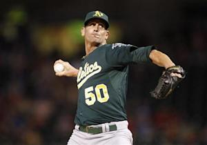 Oakland Athletics' Grant Balfour pitches against the Texas Rangers during their MLB Americcan League baseball game in Arlington, Texas