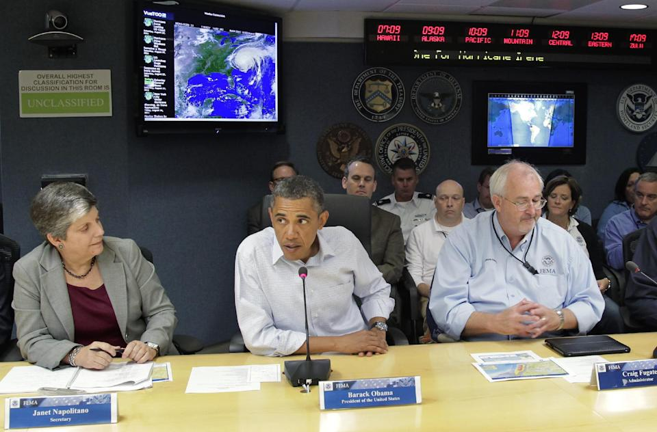 President Barack Obama receives an update on the status of Hurricane Irene at the Federal Emergency Management Agency (FEMA) headquarters in Washington, Saturday, Aug. 27, 2011. He is joined by Secretary of Homeland Security Janet Napolitano, left, and FEMA director Craig Fugate. (AP Photo/J. Scott Applewhite)