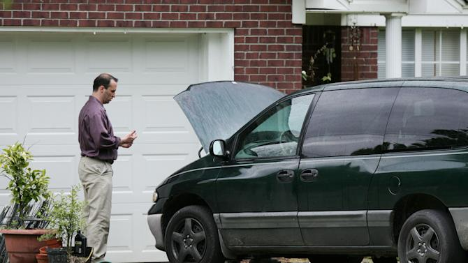 James Everett Dutschke works on his minivan in his driveway in Tupelo, Miss., Friday, April 26, 2013. FBI spokeswoman Deborah Madden says Dutschke, 41, was arrested Saturday, April 27, 2013, at his Tupelo home. U.S. Attorney Felicia C. Adams and Daniel McMullen, the FBI agent in charge in Mississippi, announced later Saturday that Dutschke has been charged with making and possessing ricin in the investigation into poison-laced letters sent to President Barack Obama, Sen. Roger Wicker of Mississippi and 80-year-old Mississippi judge Sadie Holland. (AP Photo/Northeast Mississippi Daily Journal, Thomas Wells) MANDATORY CREDIT