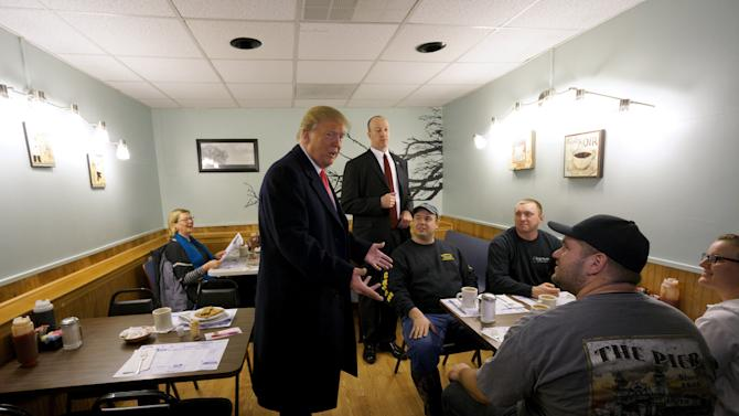 U.S. Republican presidential candidate Trump talks with guests at the Chez-Vauchon restaurant in Manchester