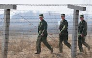 File photo shows Chinese soldiers patrolling the North Korea-China border near Dandong, in China's northeast Liaoning province. China has stopped sending fleeing North Koreans back across the border, in retaliation for Pyongyang failing to consult its ally over last week's rocket launch, a Japanese report said Wednesday