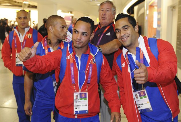 Members of the Cuban weightlifting squad arrive at Heathrow airport in London