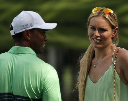 U.S. golfer Woods and Vonn smile during the par 3 event held ahead of the 2015 Masters at Augusta National Golf Course in Augusta
