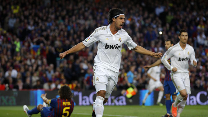 Real Madrid's Sami Khedira from Germany celebrates after scoring during a Spanish La Liga soccer match against Barcelona at the Camp Nou stadium, in Barcelona, Saturday, April 21, 2012. (AP Photo/Daniel Ochoa de Olza)