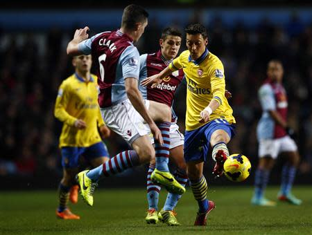 Aston Villa's Clark and Westwood challenge Arsenal's Ozil during their English Premier League soccer match at Villa Park in Birmingham