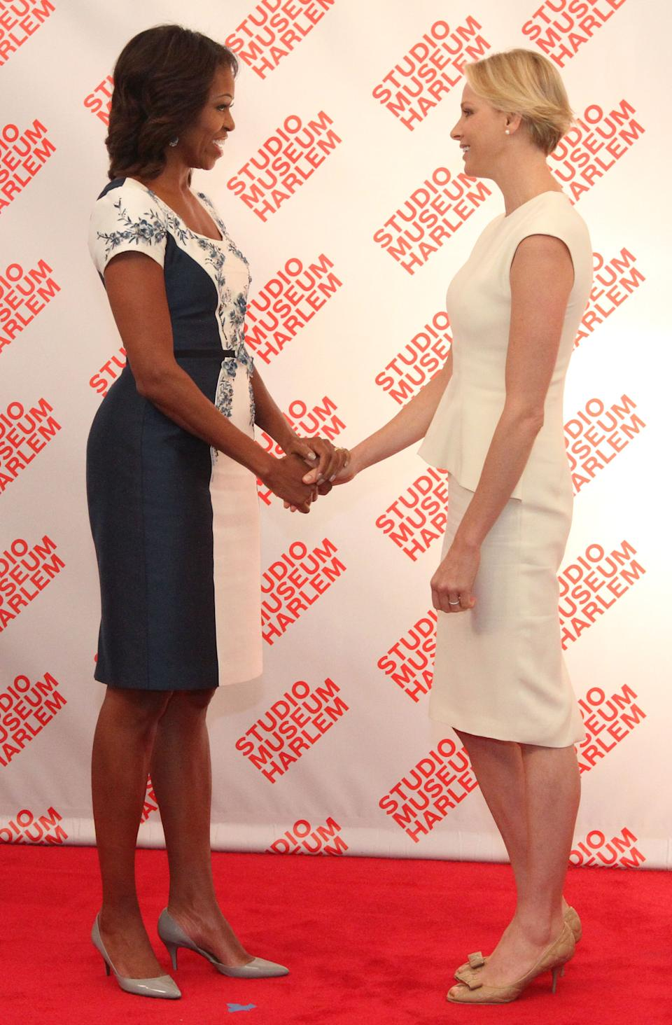 U.S. first lady Michelle Obama, left, greets Princess Charlene of Monaco during a luncheon at The Studio Museum of Harlem Tuesday Sept. 24, 2013 in New York. The first lady hosted the event for spouses of chiefs of state and heads of government participating in the UN General Assembly. (AP Photo/Tina Fineberg)