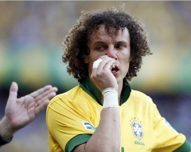 Brazil's David Luiz tries to stop his nose from bleeding during their Confederations Cup Group A soccer match against Mexico at the Estadio Castelao in Fortaleza