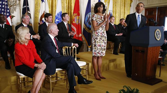 President Barack Obama speaks in the East Room of the White House in Washington, Tuesday, April 30, 2013,  about jobs for veterans. From left are, Jill Biden, wife of Vice President Joe Biden, the vice president and first lady Michelle Obama. (AP Photo/Charles Dharapak)