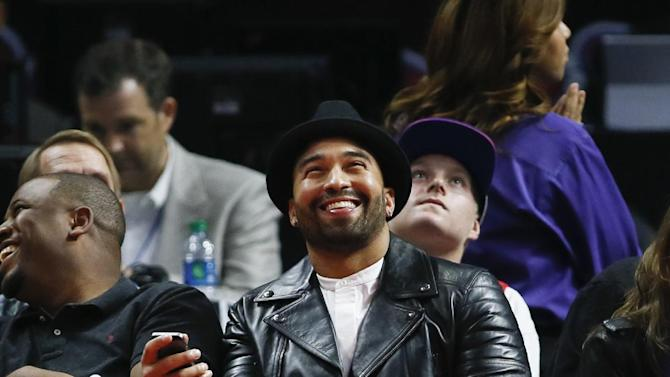 Major League Baseball player Matt Kemp of the San Diego Padres smiles as he attends an NBA basketball game between the Los Angeles Clippers and Milwaukee Bucks Saturday, Dec. 20, 2014, in Los Angeles. (AP Photo/Danny Moloshok)