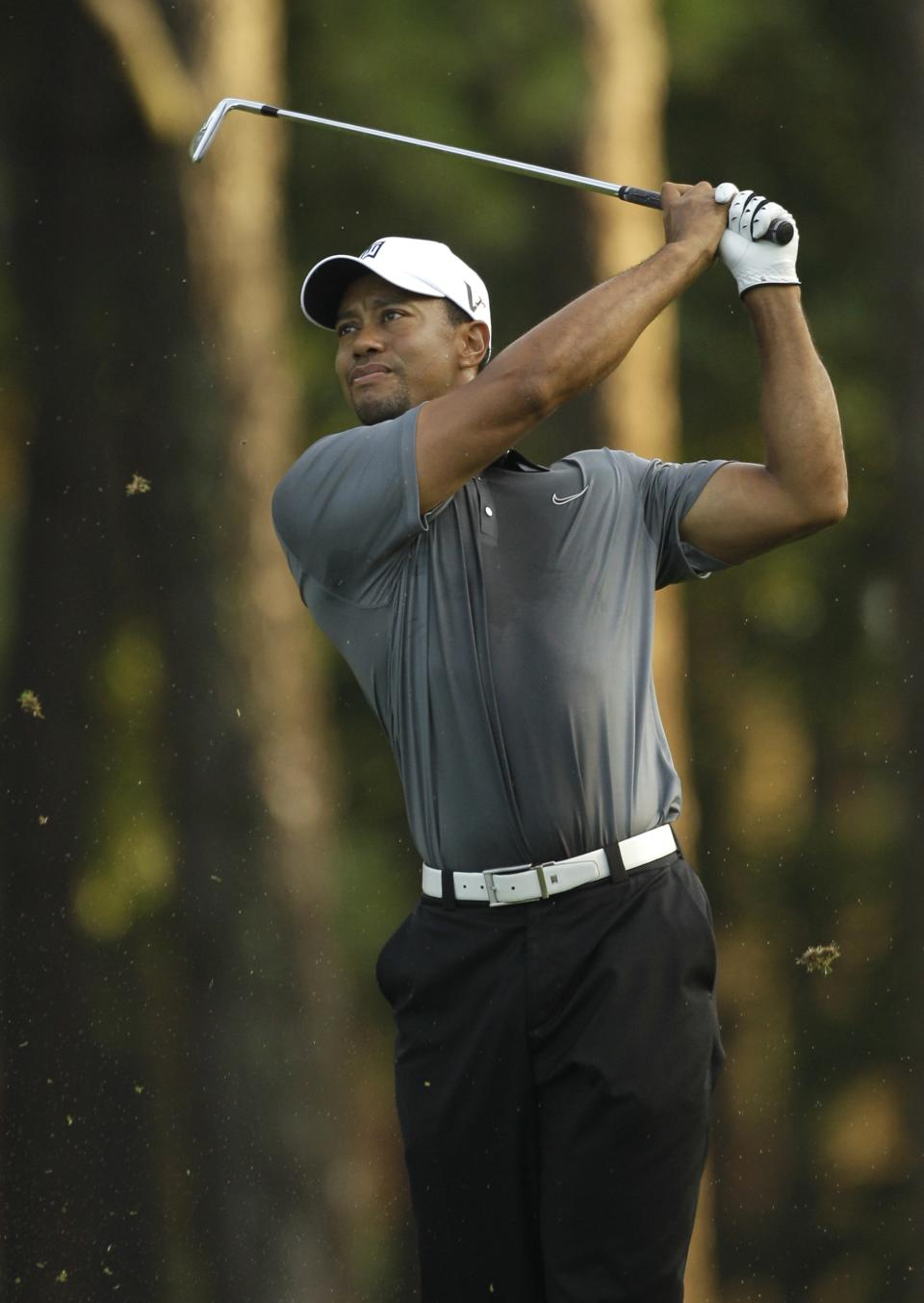 Tiger Woods hits his shot on the first fairway during the pro-am of the Wells Fargo Championship golf tournament at Quail Hollow Club in Charlotte, N.C., Wednesday, May 2, 2012. (AP Photo/Chuck Burton)