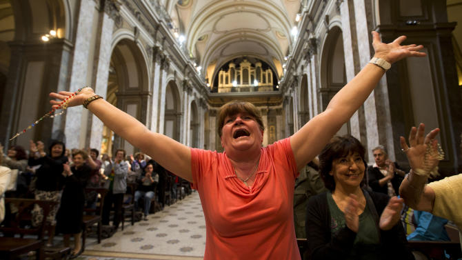 Paola La Rocca celebrates after hearing on the speakers at the Metropolitan Cathedral that Buenos Aires' Archbishop Jorge Bergoglio was chosen as Pope in Buenos Aires, Argentina, Wednesday, March 13, 2013. Bergoglio is the first pope ever from the Americas and the first from outside Europe in more than a millennium. (AP Photo/Victor R. Caivano)