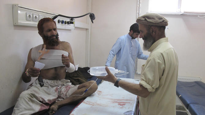 An Afghan man is treated at a hospital after he was injured in a suicide bombing in Khost, south of Kabul, Afghanistan, Monday, Oct. 1, 2012. Officials say the bomber was driving a motorcycle packed with explosives and rammed it into a patrol of Afghan and international forces, killing over a dozen people including three NATO service members. (AP Photo/Nashanuddin Khan)