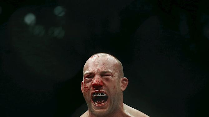 Cummins of U.S celebrates after defeating Cavalcante of Brazil during their UFC match in Rio de Janeiro