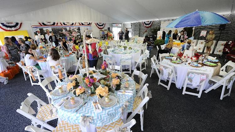 View of the tables at Operation Shower, hosted by Melissa Joan Hart and sponsored by Carousel Designs at The 2012 Barclays, on Wednesday, Aug. 22, 2012 in Farmingdale, NY. (Photo by Kathy Kmonicek/Invision for Carousel Designs/AP Images)