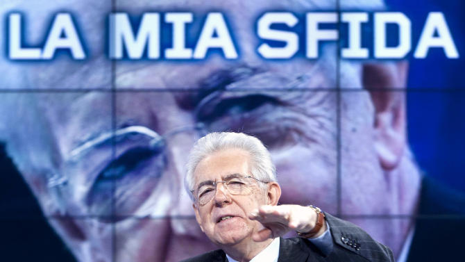 """Italian Premier Mario Monti gestures during an interview broadcast on  RAI public television Thursday, Jan. 3, 2013. Monti said a second term would demonstrate to Italians that he is not a wicked taxman. Monti, a trained economist, is heading a caretaker government in the run-up to February elections, where he is harnessing a coalition of centrist parties. Statement on the background screen reads """"My challenge"""".  (AP Photo/Robero Monaldo, Lapresse)"""