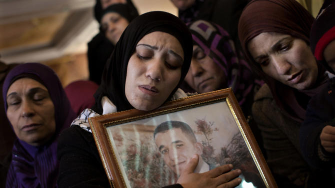 Palestinian women mourn during the funeral of Arafat Jaradat in the West Bank town of Saeer, near Hebron, Monday, Feb. 25, 2013. Thousands have attended the funeral procession of a 30-year-old Palestinian man who died under disputed circumstances in Israeli custody. Palestinian officials say autopsy results show Jaradat was tortured by Israeli interrogators, while Israeli officials say there's no conclusive cause of death yet and that more tests are needed. (AP Photo/Bernat Armangue)