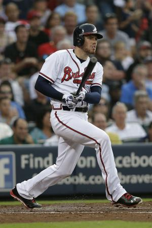 Atlanta Braves' Freddie Freeman drives in a run with a base hit in the second inning of a baseball game against the Cincinnati Reds, Thursday, July 11, 2013, in Atlanta. (AP Photo/John Bazemore)
